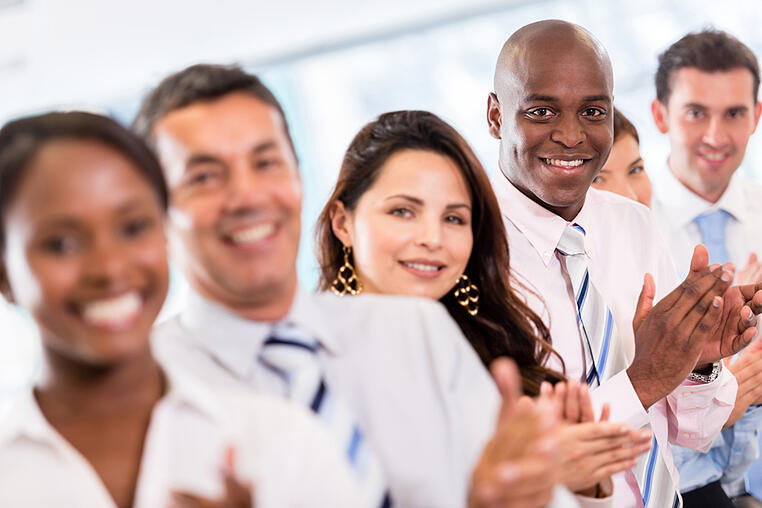 Successful business group applauding after a presentation-1